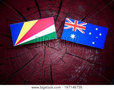 Seychelles Flag With Australian Flag On A Tree Stump Isolated