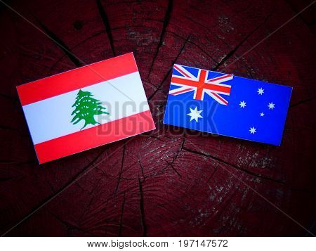 Lebanese Flag With Australian Flag On A Tree Stump Isolated