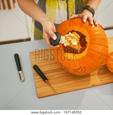 Closeup On Woman Prepare Big Orange Pumpkin For Halloween Party
