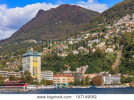 Buildings of the city of Lugano in Switzerland, the Monte Boglia mountain in the background. Lugano is the largest city of the Swiss canton of Ticino, the picture was taken in the middle of autumn.