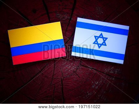 Colombian Flag With Israeli Flag On A Tree Stump Isolated