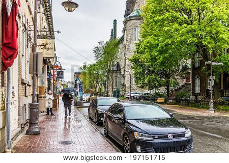 Quebec City, Canada - May 30, 2017: Saint Jean Baptiste Limoilou Area With Man Holding Umbrella Walk
