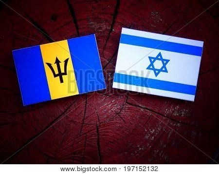 Barbados Flag With Israeli Flag On A Tree Stump Isolated