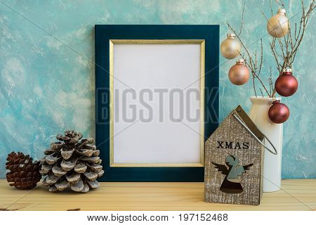 Blue and golden frame mock up Christmas New Year pine cones colorful baubles candle holder with angel figure space for quotes text artwork