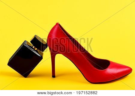 Accessories On Yellow Background As Fashion And Scent Concept