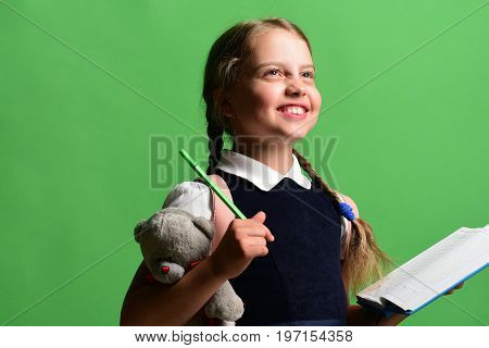 School Girl With Happy Smiling Face On Green Background