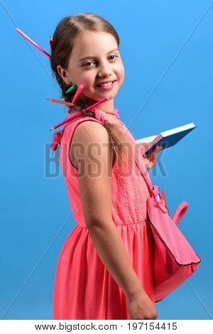 Back To School And Education Concept. Kid In Pink Dress