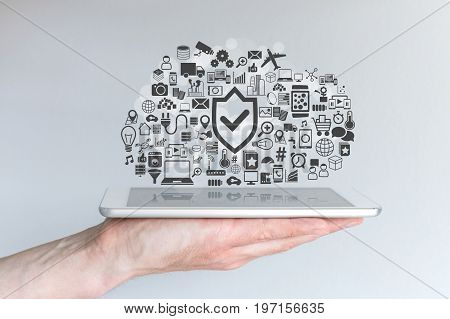Cloud computing security concept with male hand holding tablet