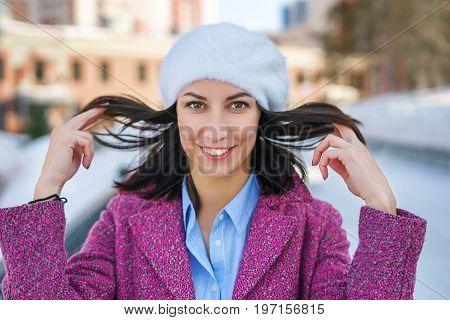 Smiling Girl Holding Her Hair
