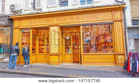 PARIS FRANCE - JUNE 6 2012: A colorful and traditional biscuit candy and chocolate delicatessen in Montmartre in Paris.