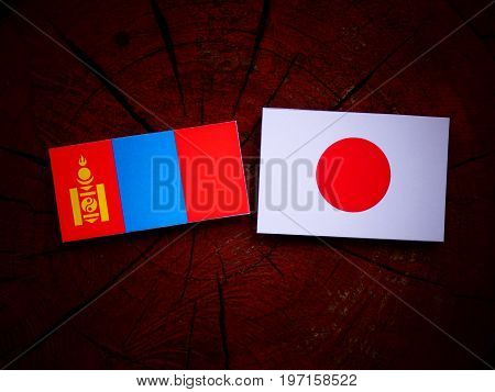 Mongolian Flag With Japanese Flag On A Tree Stump Isolated