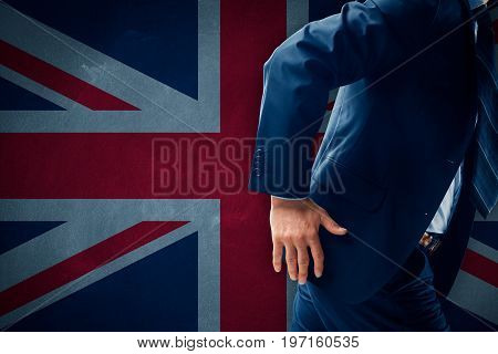 Brexit concept. Businessman (financier, bank employee, CEO manager) run away (escape) from Great Britain.