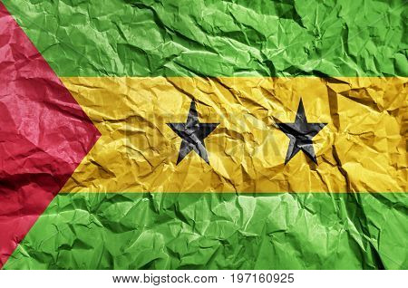 Sao Tome and Principe flag painted on crumpled paper background