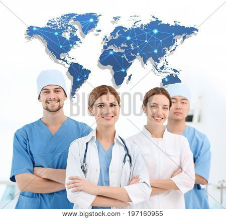 Concept of consulting. Medical staff and world map on light background