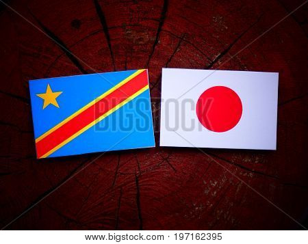 Democratic Republic Of The Congo Flag With Japanese Flag On A Tree Stump Isolated