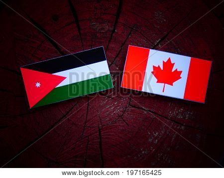 Jordanian Flag With Canadian Flag On A Tree Stump Isolated