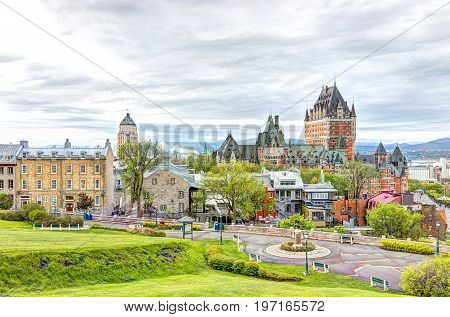 Quebec City, Canada - May 30, 2017: Cityscape Or Skyline Of Chateau Frontenac, Park And Old Town Str