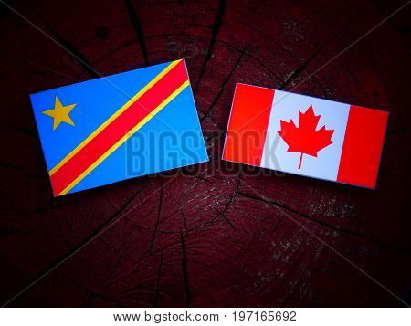 Democratic Republic Of The Congo Flag With Canadian Flag On A Tree Stump Isolated