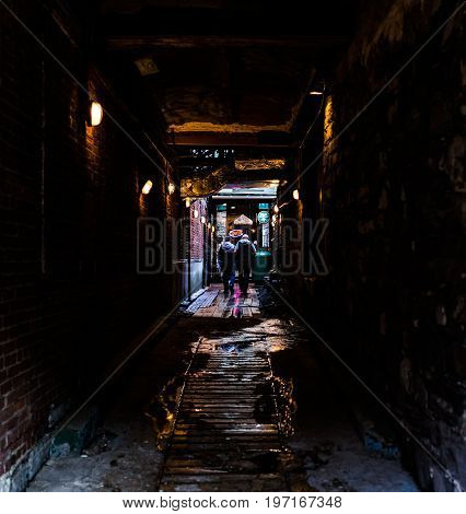 Quebec City, Canada - May 31, 2017: Old Town Street Narrow Dark Brick Alleyway Or Alley With Path To