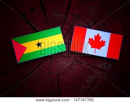 Sao Tome And Principe Flag With Canadian Flag On A Tree Stump Isolated