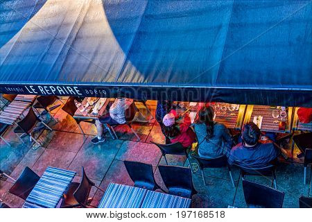 Quebec City, Canada - May 31, 2017: Le Repaire Restaurant Sign And People Sitting, Eating On Outdoor