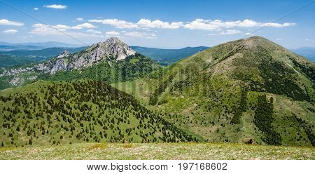 Poludnovy grun Maly Rozsutec Velky Rozsutec and Stoh hill from Steny hill in Mala Fatra mountains in Slovakia during nice day with blue sky and few clouds