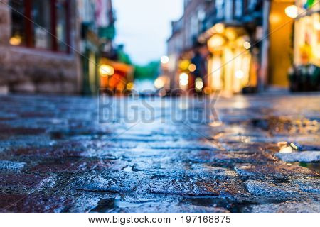 Macro Closeup Of Colorful, Vibrant And Cobblestone Street At Night After Rain With Reflection Of Lig
