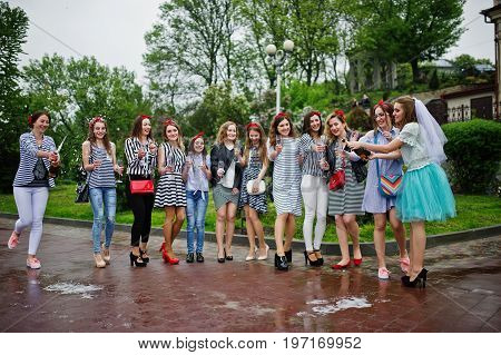 Eleven Attractive Braidsmaids With Lovely Bride Celebrating Bachelorette Party With Champagne In The