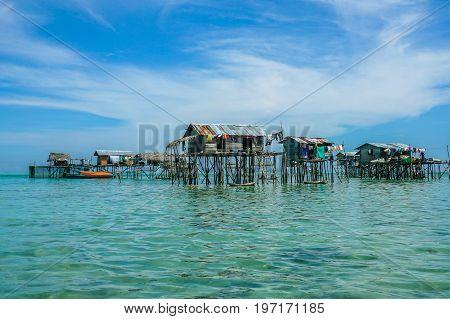 The traditional sea gypsy water village in Bodgaya Island in Tun Sakaran Marine Park,Semporna,Sabah,Borneo,Malaysia.Clear blue water & sandy beach.Beautiful vacation & destination.