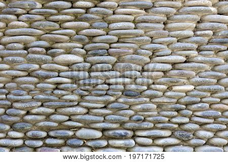Stone Wall Of Natural Stones Of Different Sizes.