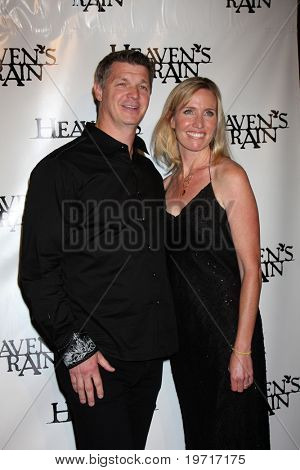 LOS ANGELES - SEP 9:  Brooks Douglass & Wife arrives at the
