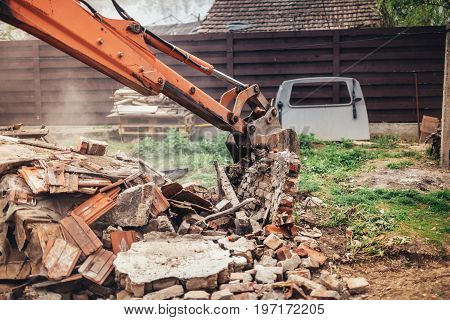 Industrial Construction Site Details With Excavator Using Scoop For Demolishing And Destroying Old H