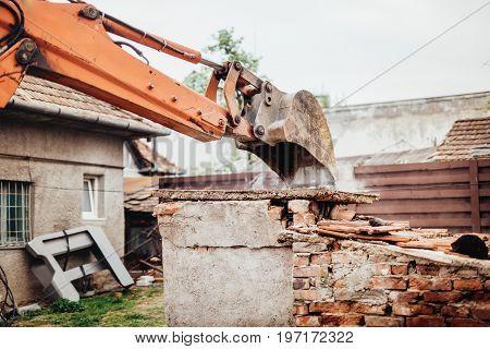 Close Up Details Of Backhoe Excavator Scoop Demolishing Ruins, Destroying And Loading Debris