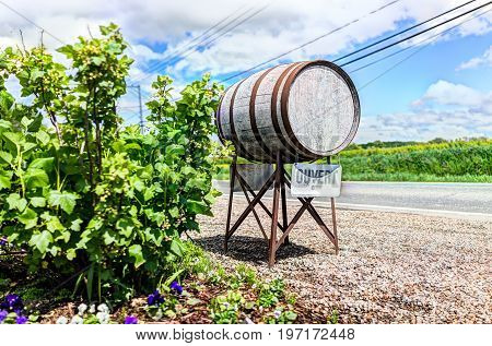 Wine Barrel Sign In French Countryside With Ouvert Open Sign By Road