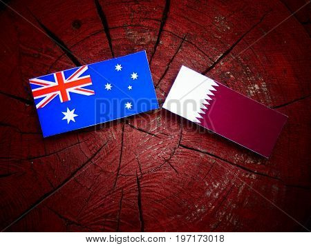 Australian  Flag With Qatari Flag On A Tree Stump Isolated