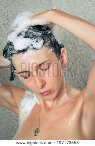 Woman close up in the home shower