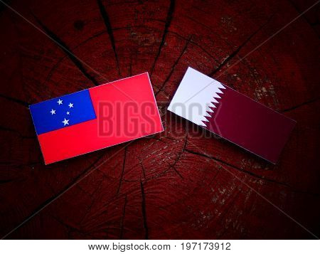 Samoa Flag With Qatari Flag On A Tree Stump Isolated