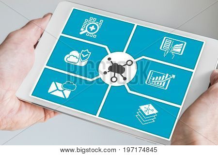Hand holding tablet. Concept of cloud computing dashboard for mobile devices.