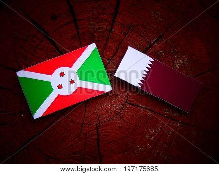 Burundi Flag With Qatari Flag On A Tree Stump Isolated