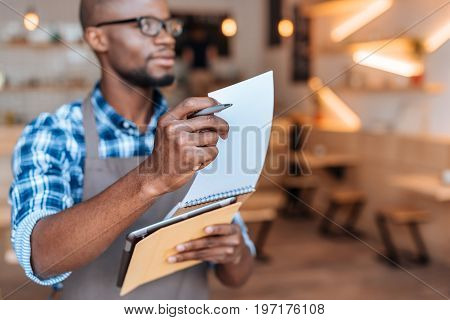 Handsome African American Waiter Taking Order With Notepad And Digital Tablet In Cafe, Selective Foc
