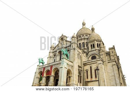 left side view of the Sacred Heart Basilica of Paris in France in Montmartre historic district of Paris city isolated on white background and copy space.
