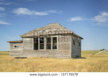 abandoned old house in Nebraska Sandhills, summer scenery