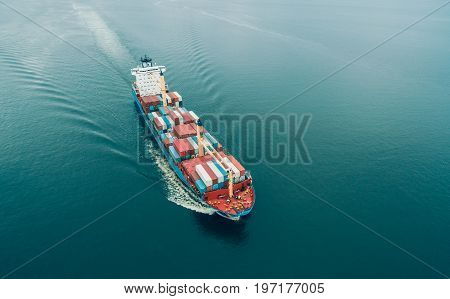 Aerial view of Cargo ship sailing in open sea