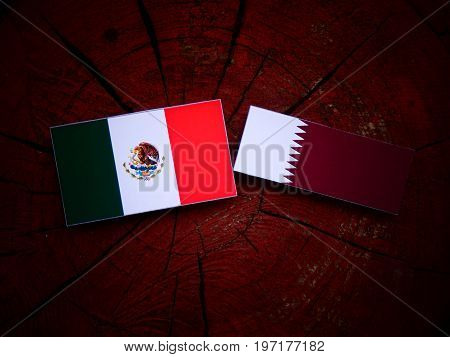 Mexican Flag With Qatari Flag On A Tree Stump Isolated