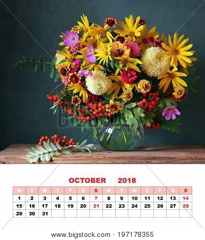 Design page calendar October 2018. Autumn bouquet with garden flowers and branches of mountain ash.