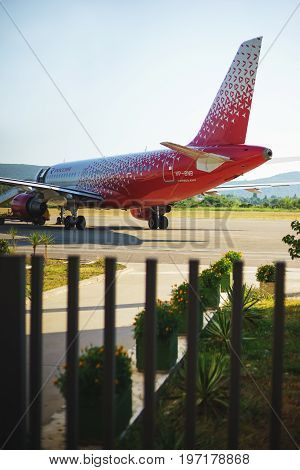 July 2017, Tivat, Montenegro. The red passenger airliner of Russia on the runway at Tivat airport is waiting for passengers to board and take off.