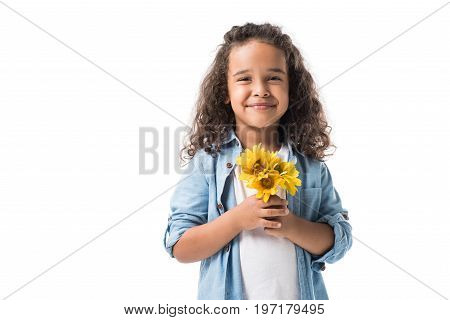 Happy African American Girl Holding Yellow Flowers And Smiling At Camera Isolated On White