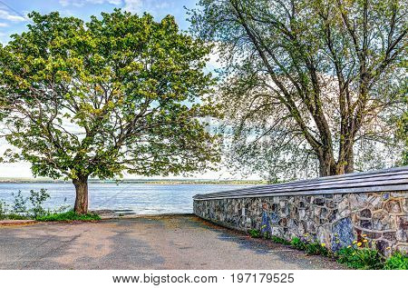 Landscape view of Saint Lawrence river from Ile D'Orleans Quebec Canada in summer with stone church wall