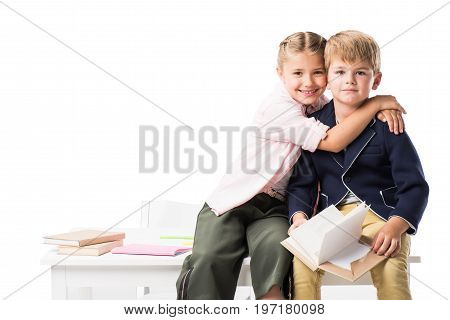 Adorable Happy Schoolkids Hugging While Studying Together Isolated On White