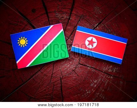 Namibian Flag With North Korean Flag On A Tree Stump Isolated